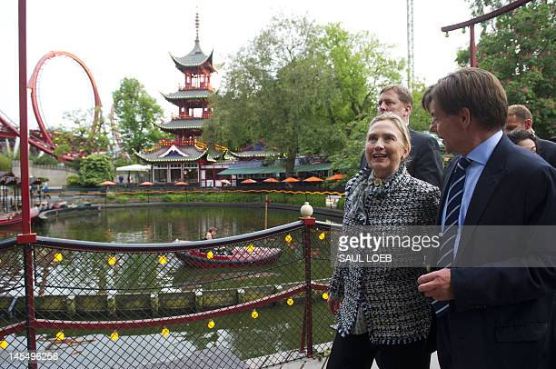 US Secretary of State Hillary Clinton walks through the Tivoli Gardens Amusement Park after having dinner at a restaurant at the park in Copenhagen...