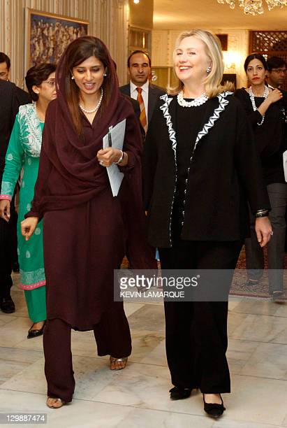 US Secretary of State Hillary Clinton walks with Pakistan's Foreign Minister Hina Rabbani Khar in Islamabad on October 21 2011 The United States has...