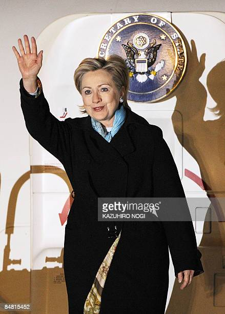 US Secretary of State Hillary Clinton waves as she arrives at Tokyo's Haneda Airport on February 16 2009 Clinton arrived in Japan to kick off an Asia...