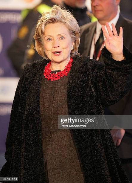 Secretary of State Hillary Clinton waves to reporters as she arrives for the final day of the UN Climate Change Conference on December 18 2009 in...