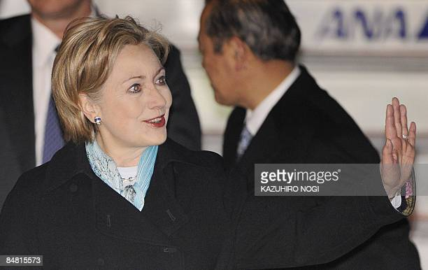 US Secretary of State Hillary Clinton waves upon her arrival at Tokyo's Haneda Airport on February 16 2009 Clinton arrived in Japan to kick off an...