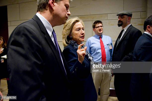 Secretary of State Hillary Rodham Clinton after a bipartisan briefing by her Defense Secretary Robert M Gates on the situation in Libya for members...