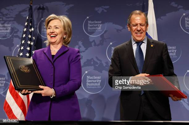 Secretary of State Hillary Rodham Clinton and Russian Foreign Minister Sergey Lavrov smile after signing an agreement on eliminating excess...