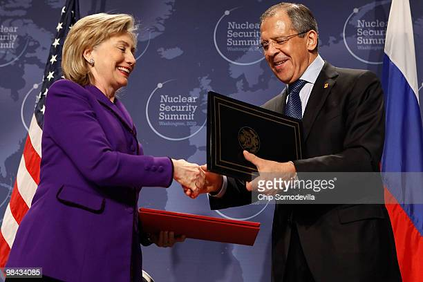 S Secretary of State Hillary Rodham Clinton and Russian Foreign Minister Sergey Lavrov exchange signed copies of an agreement on eliminating excess...