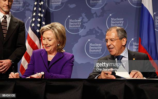 Secretary of State Hillary Rodham Clinton and Russian Foreign Minister Sergey Lavrov sign copies of an agreement on eliminating excess weapon-grade...