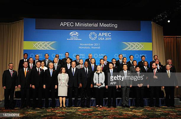 Secretary of State Hillary Rodham Clinton and US Trade Representative Ron Kirk pose for a photo with APEC Foreign and Trade Ministers after their...