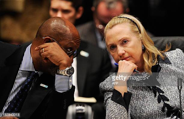 Secretary of State Hillary Rodham Clinton and US Trade Representatives Ron Kirk speak during the APEC Ministerial meeting on November 11 2011 in...