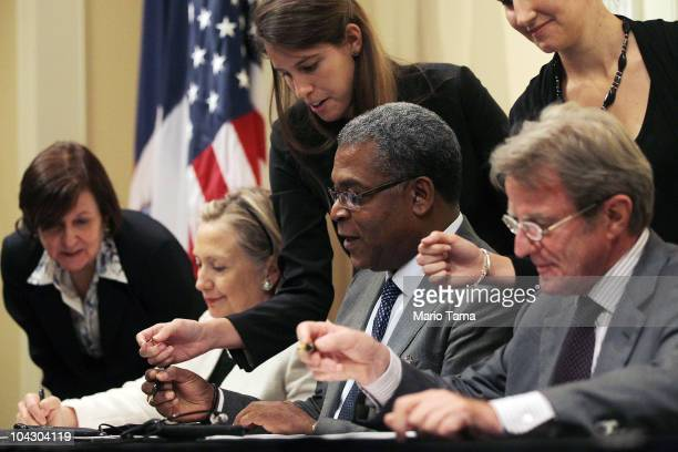 US Secretary of State Hillary Rodham Clinton Haitian Prime Minister JeanMax Bellerive and French Foreign Minister Bernard Kouchner sign a Memo of...