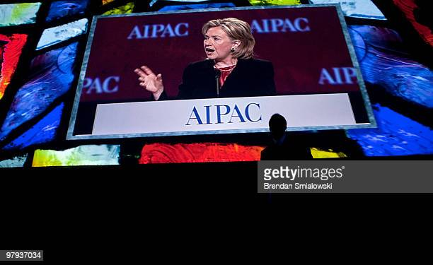 Secretary of State Hillary Rodham Clinton is seen on a screen as she speaks during the 2010 American Israel Public Affairs Committee conference March...