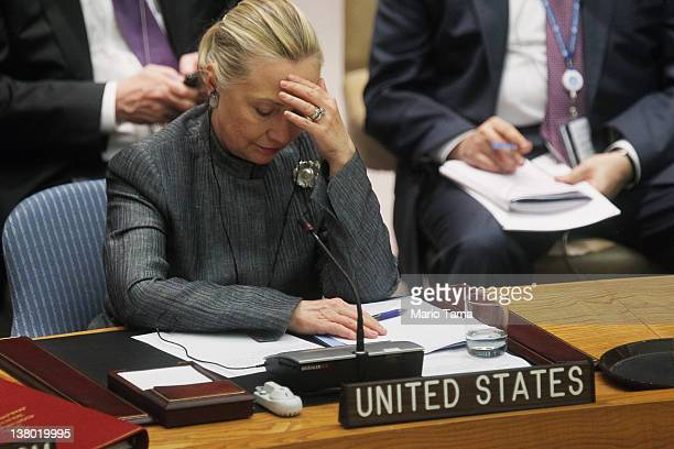 S Secretary of State Hillary Rodham Clinton listens as Bashar Ja'Afari Syrian ambassador to the United Nations speak at a United Nations Security...