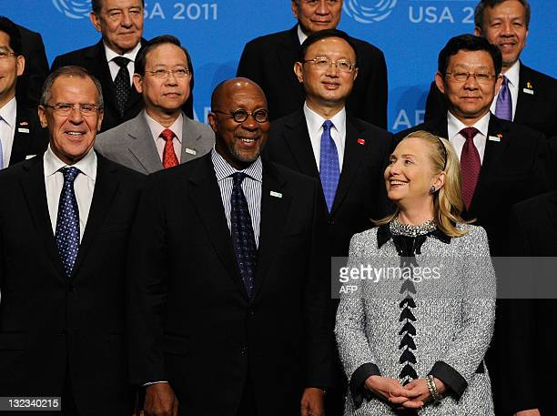 Secretary of State Hillary Rodham Clinton looks at US Trade Representative Ron Kirk as they pose with Foreign Minister of Russia Sergey Lavrov and...