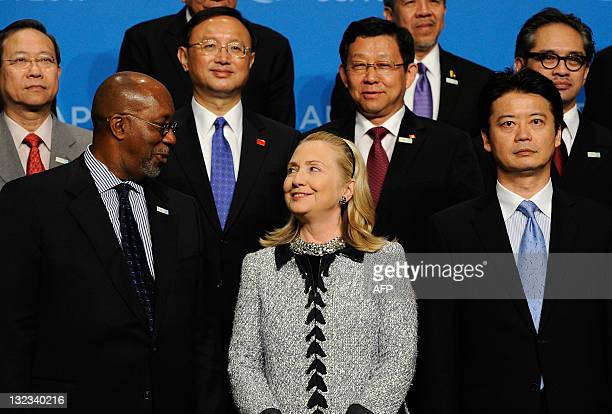 Secretary of State Hillary Rodham Clinton looks at US Trade Representative Ron Kirk as they pose with Foreign Minister of Japan Koichiro Gemba and...