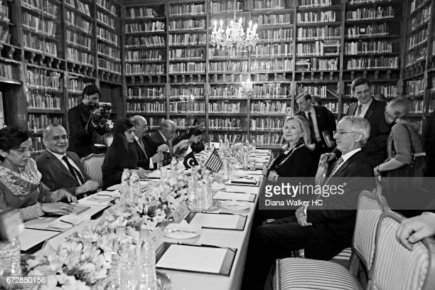 Secretary of State Hillary Rodham Clinton sits across from her Pakistani counterpart Foreign Minister Hina Rabbani Khar along with delegations from...