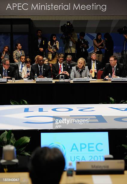 Secretary of State Hillary Rodham Clinton speaks as US Trade Representatives Ron Kirk looks on during the APEC Ministerial meeting on November 11...