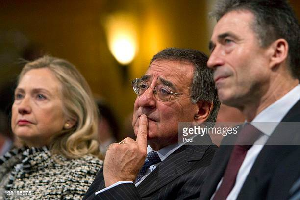 S Secretary of State Hillary Rodham Clinton US Defense Secretary Leon Panetta and NATO Secretary General Anders Fogh Rasmussen listen during day two...