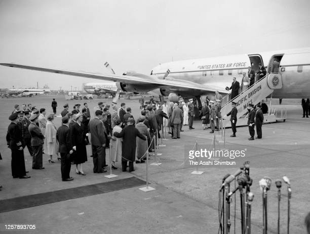 Secretary of State John Foster Dulles is welcomed by Japanese Foreign Minister Mamoru Shigemitsu on arrival at Haneda Airport on March 18, 1956 in...