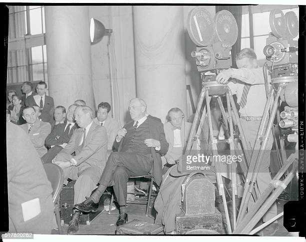 Secretary of State John Foster Dulles sat with newsmen and camera crews after reviewing the ArabIsrael dispute before the Senate Foreign Relations...
