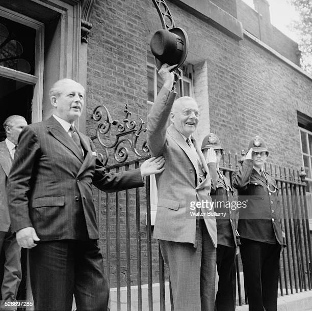 US Secretary of State John Foster Dulles waves to the crowd whilst on a visit to the Prime Minister of the United Kingdom Harold Macmillan at 10...