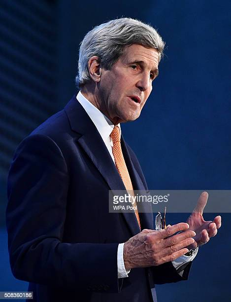 Secretary of State John Kerry addresses delegates during the first 'Thermatic Pledging Session' at the 'Supporting Syria Conference' at The Queen...