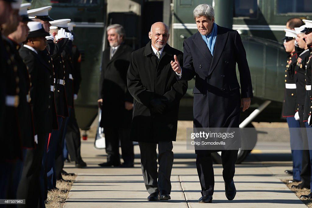 U.S. Secretary of State John Kerry (R) and Afghanistan President Ashraf Ghani arrive at Camp David ahead of talks March 23, 2015 in Camp David, Maryland. After a series of meetings about security, economic development, American support for the Afghan-led reconciliation process, the four leaders will hold a news conference.