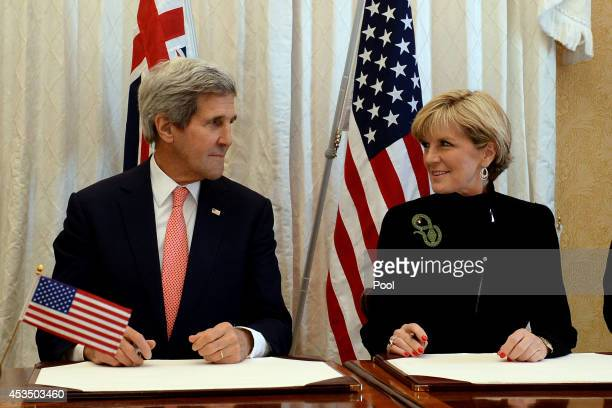 Secretary of State John Kerry and Australian Foreign Minister Julie Bishop sign a Force Posture Agreement during the AUSMIN talks at Admiralty House...