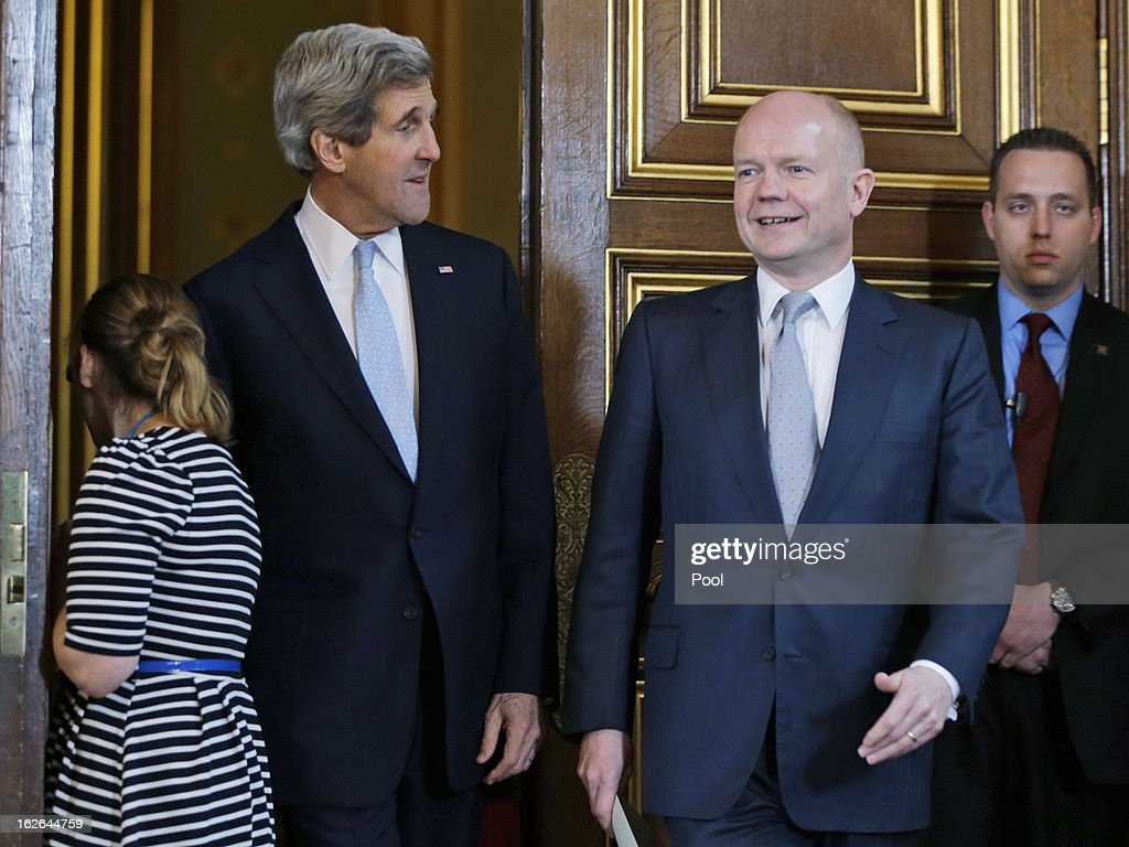 U.S. Secretary of State John Kerry (2nd L) and British Foreign Secretary William Hague (2nd R) arrive for a joint news conference after a meeting February 25, 2013 in in London, England. Kerry, during his firest overseas trip as U.S. Secretary of State, is on an 11-day tour that will bring him to Berlin, Paris, Rome, Ankara, Cairo, Riyadh, Abu Dhabi and Doha.