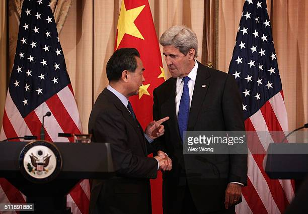 S Secretary of State John Kerry and Chinese Foreign Minister Wang Yi shake hands after a joined news conference at the State Department February 23...