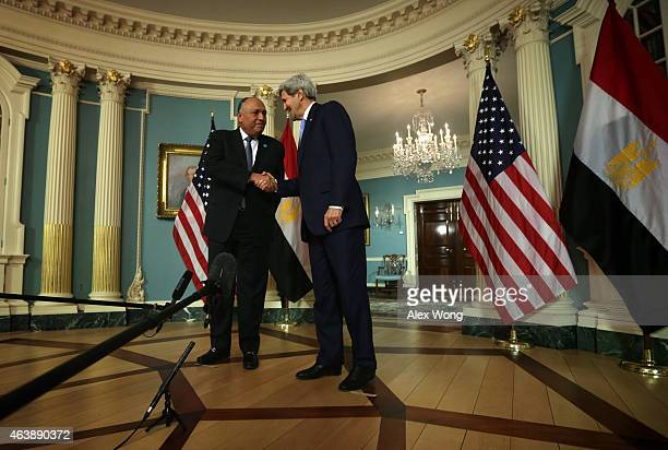 Secretary of State John Kerry and Egyptian Foreign Minister Sameh Shoukry shake hands after they spoke to members of the media prior to a meeting...