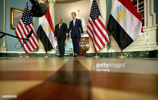 Secretary of State John Kerry and Egyptian Foreign Minister Sameh Shoukry come out to speak to members of the media prior to a meeting February 19,...