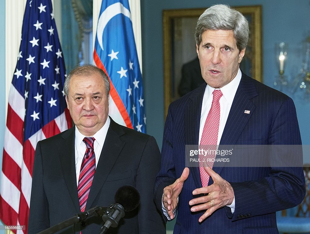 US Secretary of State John Kerry(R) and Foreign Minister of Uzbekistan, Abdulaziz Kamilov, deliver brief remarks to the media at the Department of State in Washington, DC March 12, 2013. AFP PHOTO/Paul J. Richards