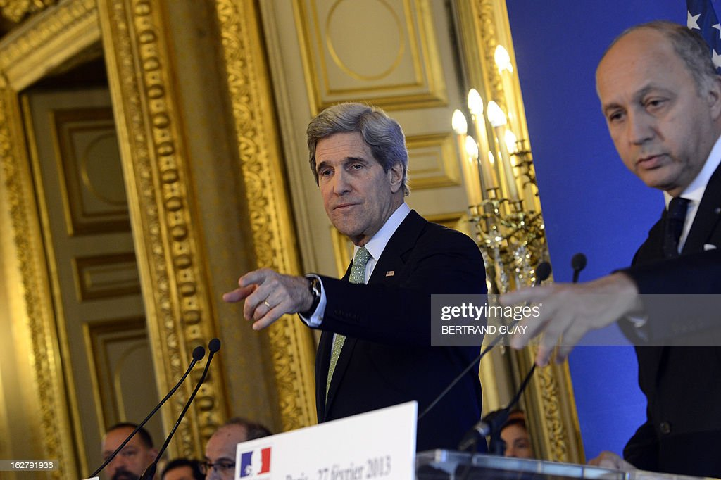 U.S. Secretary of State John Kerry (L) and French Minister of Foreign Affairs, Laurent Fabius, give a press conference on February 27, 2013 at the Foreign Ministry in Paris. Kerry began on February 24 a marathon tour of allies in Europe and the Middle East.