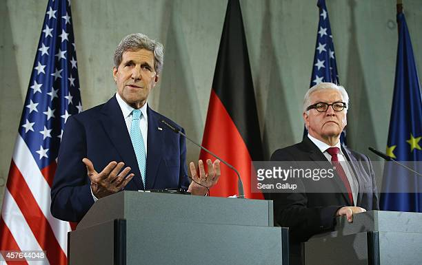 S Secretary of State John Kerry and German Foreign Minister FrankWalter Steinmeier speak to the media following a tour of the Berlin Wall memorial on...
