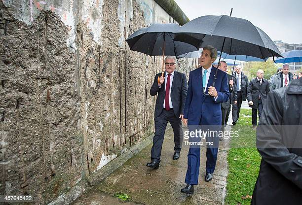 S Secretary of State John Kerry and German Foreign Minister FrankWalter Steinmeier touring the Berlin Wall memorial on October 22 2013 in Berlin...