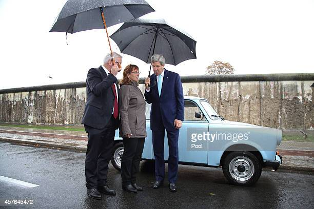S Secretary of State John Kerry and German Foreign Minister FrankWalter Steinmeier chat with Regina WebertLehmann who in 1989 fled from communist...