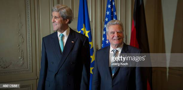 Secretary of State John Kerry and German President Joachim Gauck meet at the 50th Munich Security Conference in the Bayerischer Hof hotel on January...