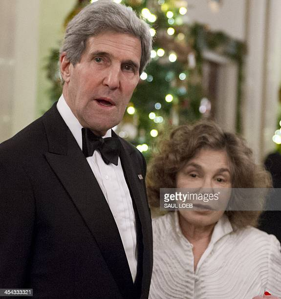 US Secretary of State John Kerry and his wife Teresa Heinz Kerry arrive for a reception for Kennedy Center honorees hosted by US President Barack...