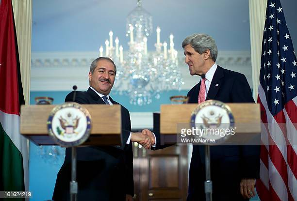 S Secretary of State John Kerry and Jordanian Foreign Minister Nasser Judeh shake hands during a joint press conference at the State Department...