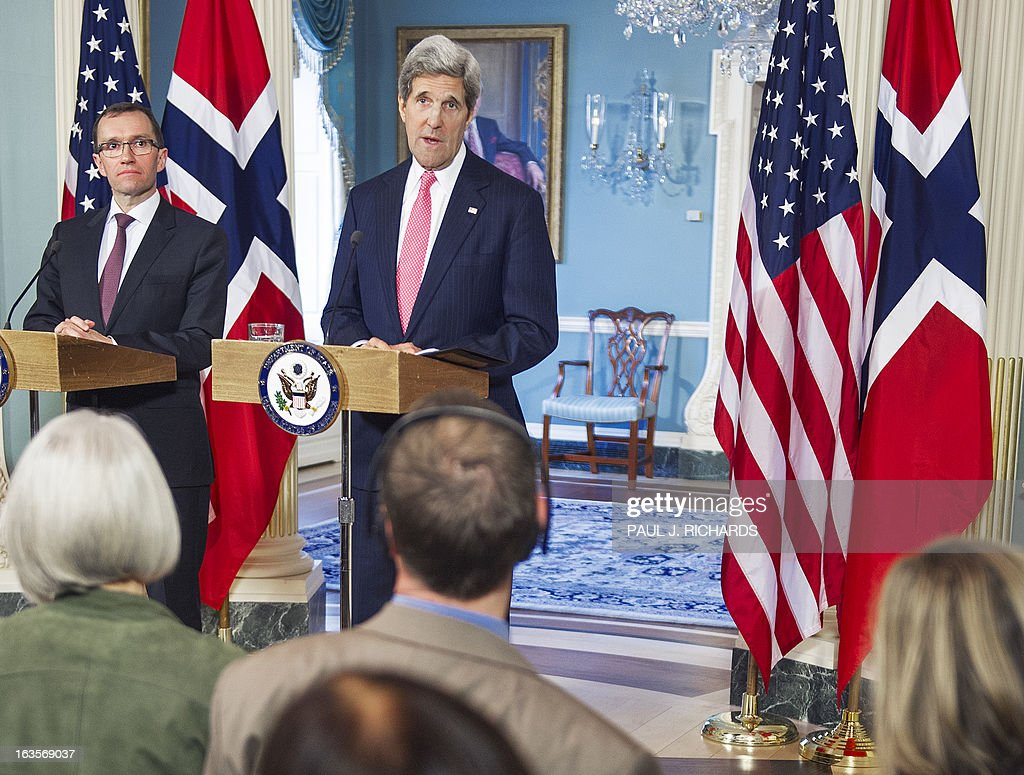 US Secretary of State John Kerry (R) and Norwegian Foreign Minister Espen Barth Eide speak to the media in the Treaty Room of the State Department on March 12, 2013 in Washington