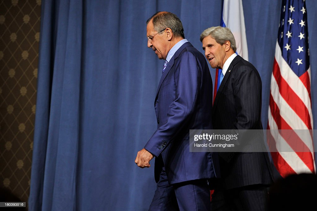 US Secretary of State John Kerry (R) and Russian Foreign Minister Sergey Lavrov leave a press conference at the Hotel Intercontinental on September 12, 2013 in Geneva, Switzerland. The leaders met to discuss chemical weapons in Syria in working towards assisting a U.N. Security Council resolution.