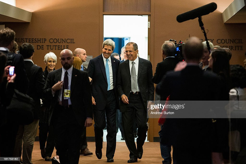 U.S. Secretary of State John Kerry (L) and Russian Foreign Minister Sergey Lavrov walk down a hall to shake hands in front of the media on the sidelines of the 68th United Nations General Assembly on September 24, 2013 in New York City. Over 120 prime ministers, presidents and monarchs are gathering this week for the annual meeting at the temporary General Assembly Hall at the U.N. headquarters while the General Assembly Building is closed for renovations.