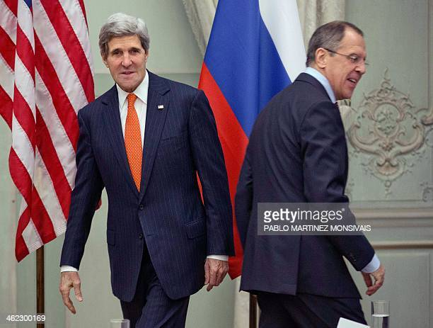 US Secretary of State John Kerry and Russia's Foreign Minister Sergey Lavrov head for their seats after greeting each other before the start of their...