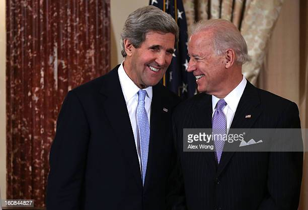 S Secretary of State John Kerry and Vice President Joseph share a moment during Kerry's ceremonial swearing in at the State Department February 6...