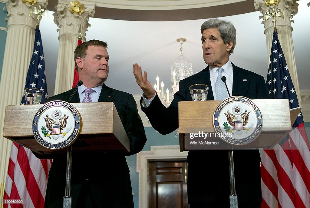 U.S. Secretary of State John Kerry (R) answers a question with Canadian Foreign Minister John Baird (L) during a press conference after a bilateral meeting at the State Department February 8, 2013 in Washington, DC. Kerry said that the U.S. government continues to evaluate options to solve problematic relations with both the Syrian and Iranian governments.