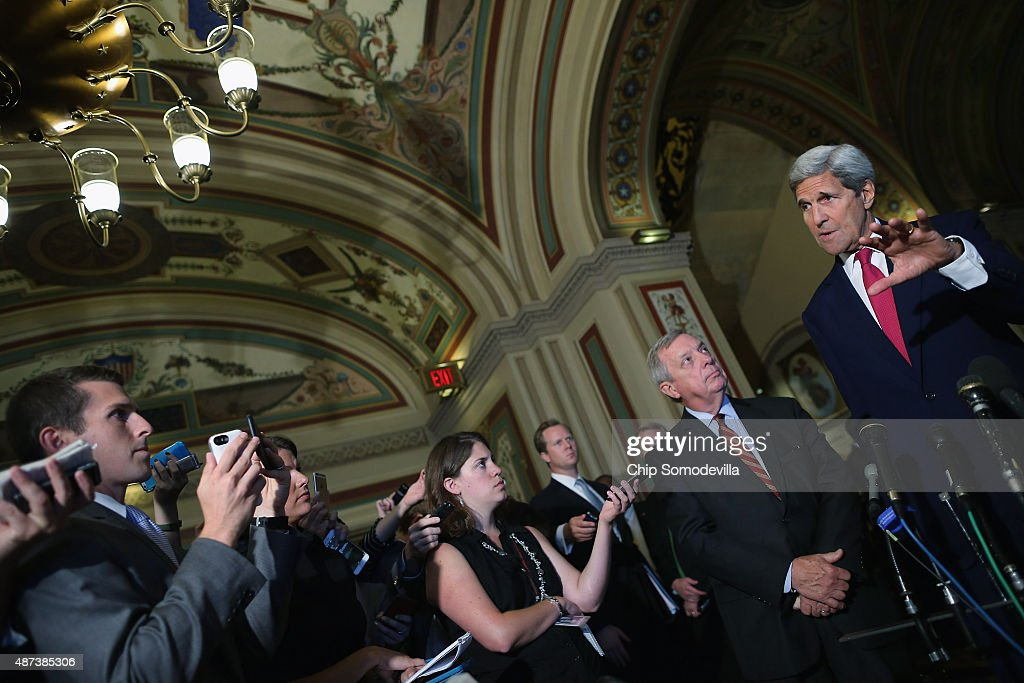 U.S. Secretary of State John Kerry (R) answers reporters' questions after meeting with Senate Minority Whip Richard Durbin (D-IL) (2nd R) and other members of Congress at the U.S. Capitol September 9, 2015 in Washington, DC. Joined by Energy Secretary Ernest Moniz, Kerry briefed members of the House and Senate about the Syrian refugee crisis in Europe and the Iran nuclear deal.