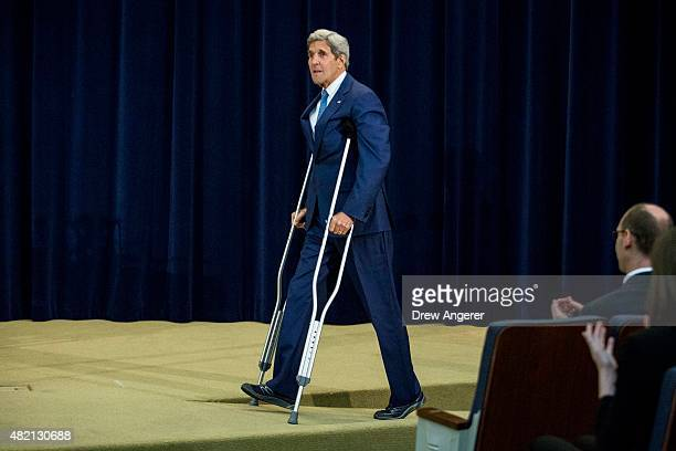 """Secretary of State John Kerry arrives during an event releasing the """"2015 Trafficking in Persons Report,"""" at the U.S. State Department, July 27, 2015..."""