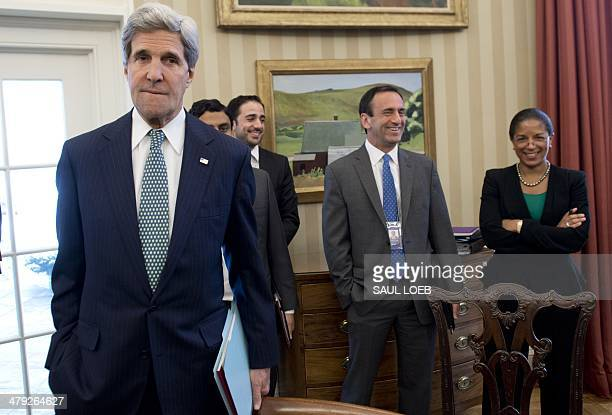 US Secretary of State John Kerry attends a meeting between US President Barack Obama and Palestinian President Mahmud Abbas in the Oval Office of the...