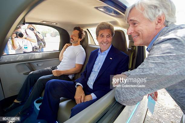 US Secretary of State John Kerry chats with Google CoFounder Sergey Brin and a leader of Google's SelfDriving Car Project while sitting inside one of...