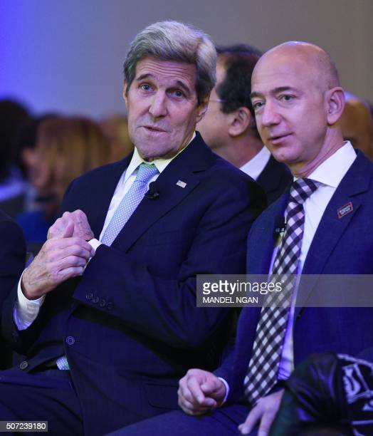 US Secretary of State John Kerry chats with The Washington Post owner Jeff Bezos during the inauguration of the Washington Post Headquarters on...