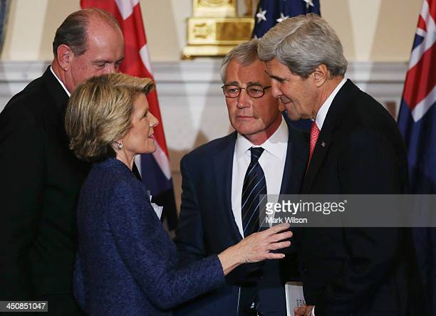 Secretary of State John Kerry , Defense Secretary Chuck Hagel talk with Australian Foreign Minister Julie Bishop and Australian Defense Minister...
