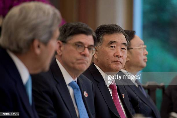 Secretary of State John Kerry delivers a speech next to US Treasury Secretary Jacob Lew Chinese vice premier Wang Yang and China's State Councillor...